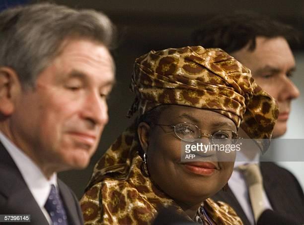 Nigerian Finance Minister Ngozi OkonjoIweala looks toward World Bank President Paul Wolfowitz as the UK's Chancellor of the Exchequer Gordon Brown...