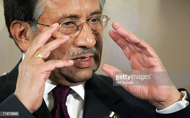 Pakistani President Pervez Musharaff speaks during a joint press conference with US President George W Bush in the East Room of the White House 22...