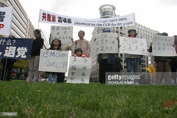 Washington, UNITED STATES: People take part in a demonstration in Washington, DC, 28 October 2006 in support of Jia Jia, a Chinese Communist Party...