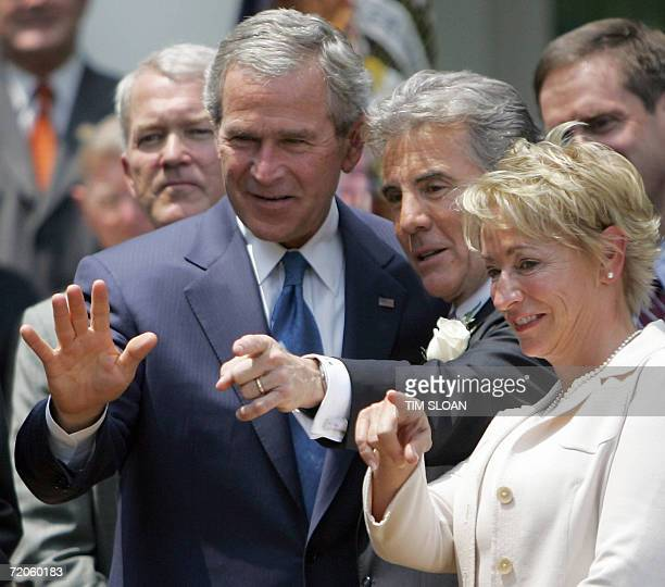 President George W Bush talks with John Walsh and Walsh's wife Reve before the Signing of HR 4472 the Adam Walsh Child Protection and Safety Act of...