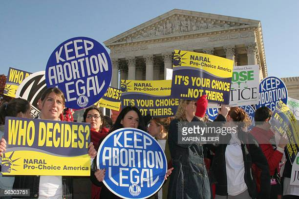 Prochoice demonstrators wave signs in front of the US Supreme Court 30 November 2005 in WashingtonDCThe US Supreme Court prepared to take up an...