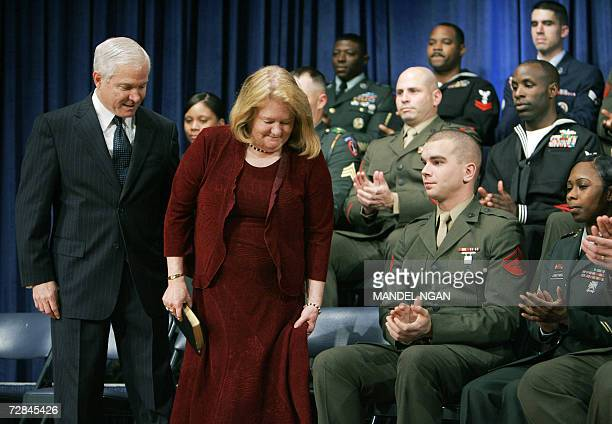 Robert Gates and his wife Becky are applauded by military personnel during Gates' ceremonial swearingin as the 22nd US defense secretary at the...