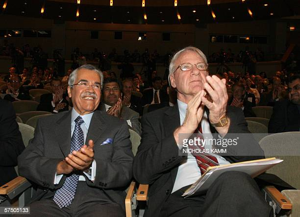 Saudi Oil Minister Ali alNuaimi and former US Defense and Energy Secretary James Schlesinger applaud as Saudi Aramco president and CEO Abdullah Jumah...