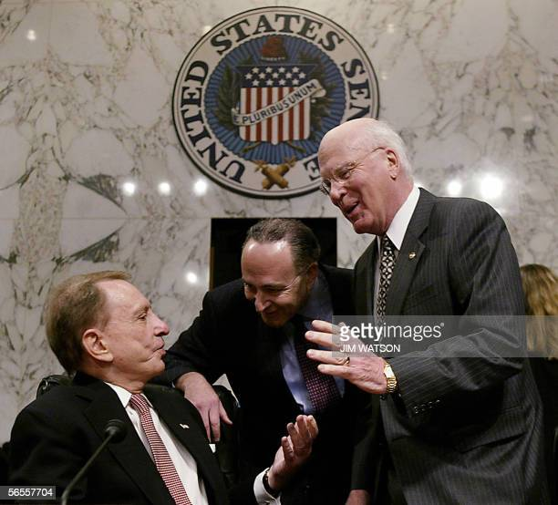 Senator Arlen Specter R PA talks with Senator Patrick Leahy DVT and Senator Charles Schumer DNY before the Senate Judiciary Committee confirmation...