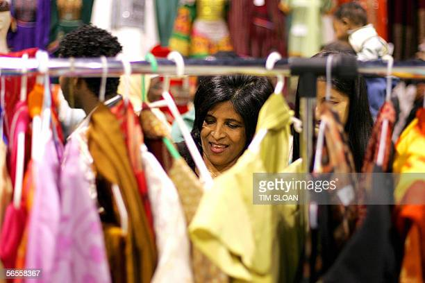 Shemim Iman of Fairfax Virginia shops at the bazar market for imported dresses from the Middle East during a celebration of Eid alAdha 10 January...