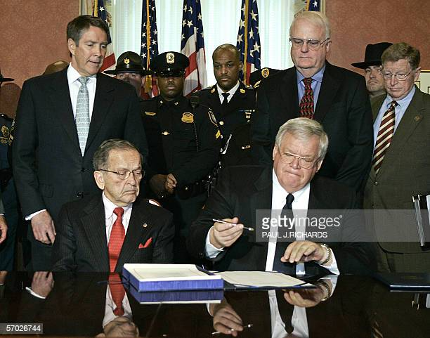 Speaker of the US House of Representatives Dennis Hastert RIL signs the USA Patriot Act renewal legislation during ceremonies 08 March 2006 on...