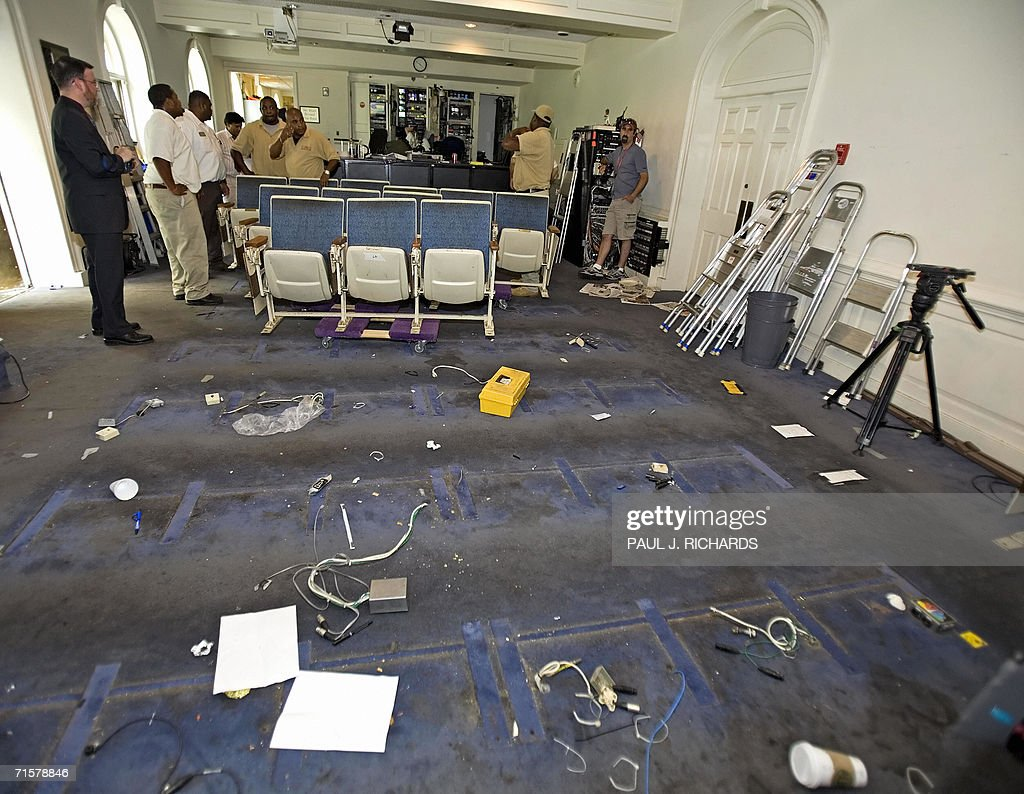 The gutted White House Press Room reveals a blue carpet after removing the banks of theatre chairs 03 August, 2006, as the area closes down for remodeling. The run-down press room will take nine months to remodel and bring it into the 21st century. AFP Photo/Paul J. Richards