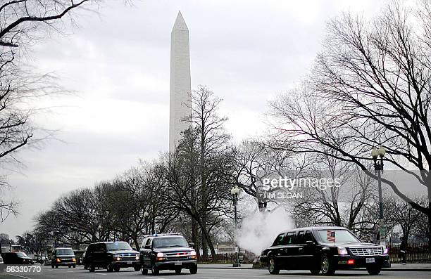 The motorcade of US President George W Bush passes the Washington Monument as it heads back to the White House from the Commerce Department 09...