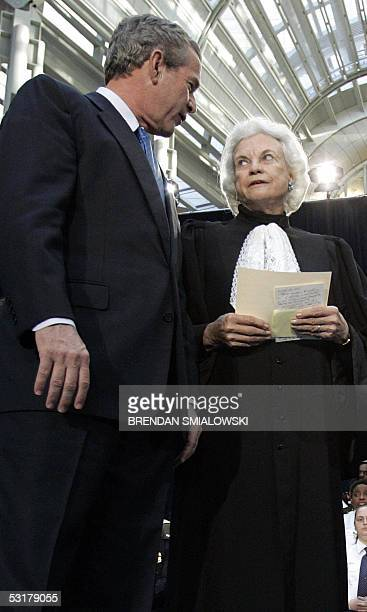 This 03 March file photo shows US President George W Bush speaking with US Supreme Court Justice Sandra Day O'Connor during the swearingin ceremony...