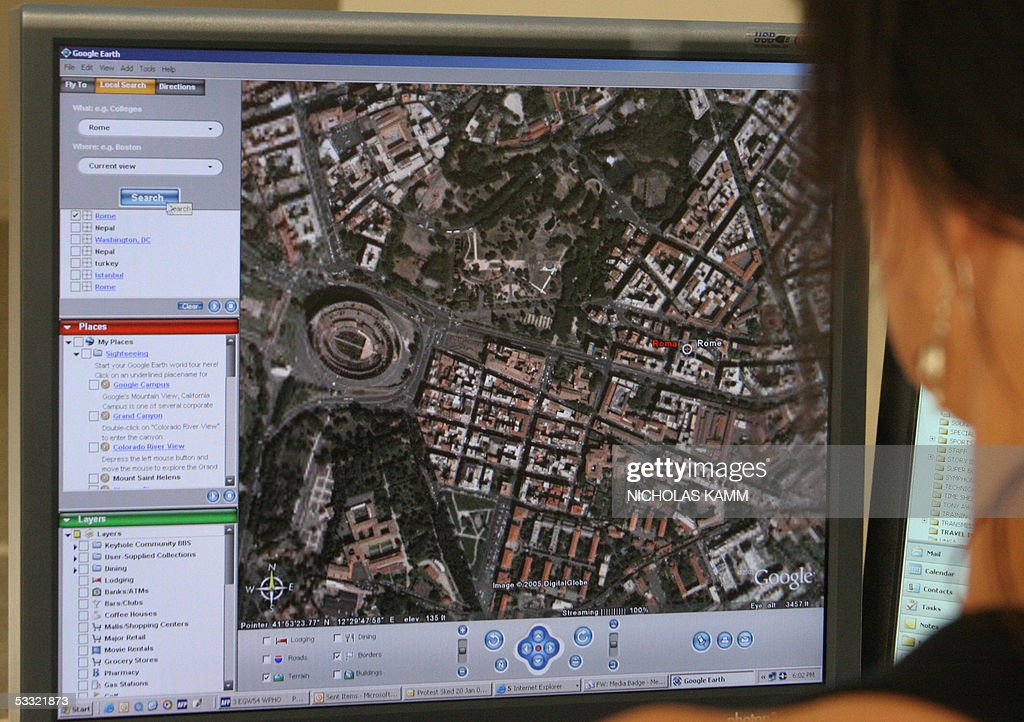 STORY 'AFPLIFESTYLE-US-INTERNET-GOOGLE' A woman looks at a view of the Italian capital Rome on Google Earth in Washington 03 August 2005. The world at your fingertip, with the click of a computer mouse: That's what Internet giant Google is offering in a new program allowing web surfers to fly around the world in a matter seconds, hopping from one destination to another across the sky. AFP PHOTO/Nicholas KAMM