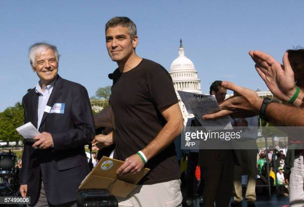 US actor George Clooney escorts his father Nick Clooney before the elder Clooney addressed a rally on the National Mall in Washington 30 April 2006...