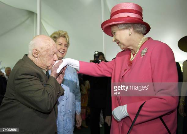 US actor Mickey Rooney kisses the hand of Queen Elizabeth II of England during a garden party celebrating her state visit to the US at the British...