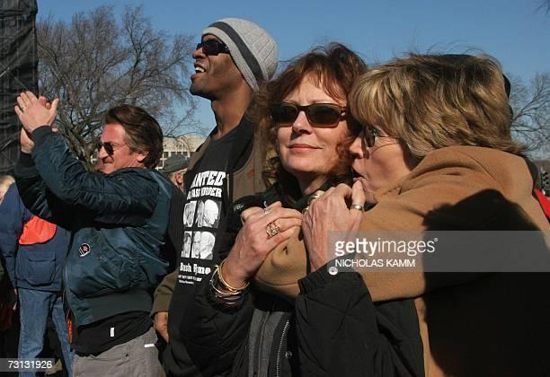 US actress Jane Fonda hugs fellow actress Susan Sarandon after she addressed an antiwar demonstration on the National Mall in Washington 27 January...