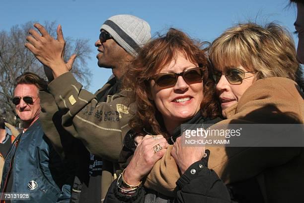 Washington, UNITED STATES: US actress Jane Fonda hugs fellow actress Susan Sarandon after she addressed an anti-war demonstration on the National...