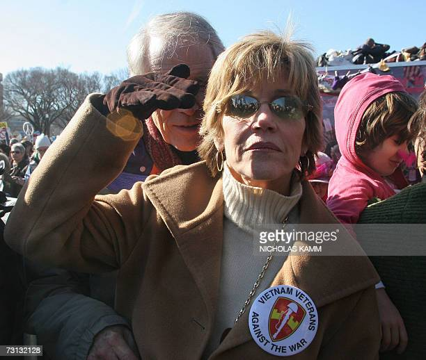 Washington, UNITED STATES: US actress Jane Fonda shields herself from the sun during an anti-war demonstration on the National Mall in Washington 27...