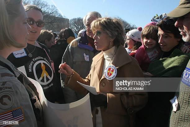 Washington, UNITED STATES: US actress Jane Fonda talks with protestors during an anti-war demonstration on the National Mall in Washington 27 January...