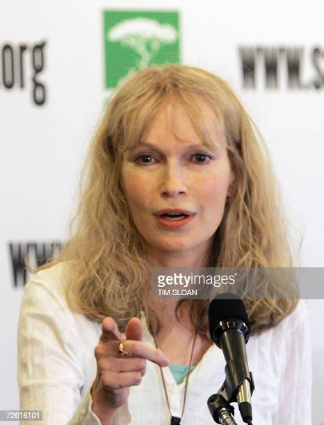 Washington, UNITED STATES: US actress Mia Farrow holds a press conference 21 November 2006 at the National Press Club in Washington, DC on her recent...