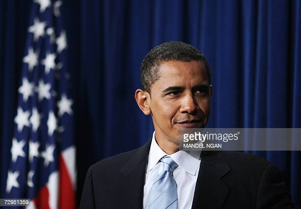 US Democratic Senator from Illinois Barack Obama smiles as he arrives for a press conference 08 January 2007 by Democrats on ethics reform at the...