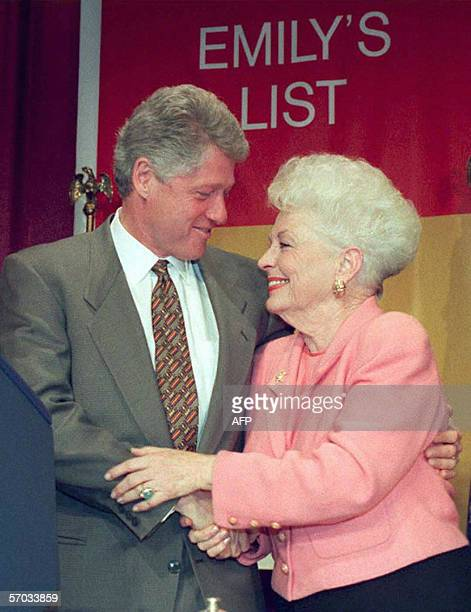 US President Bill Clinton is greeted by former Texas Governor Ann Richards at a luncheon to celebrate the 10th anniversary of Emily's List in this 01...