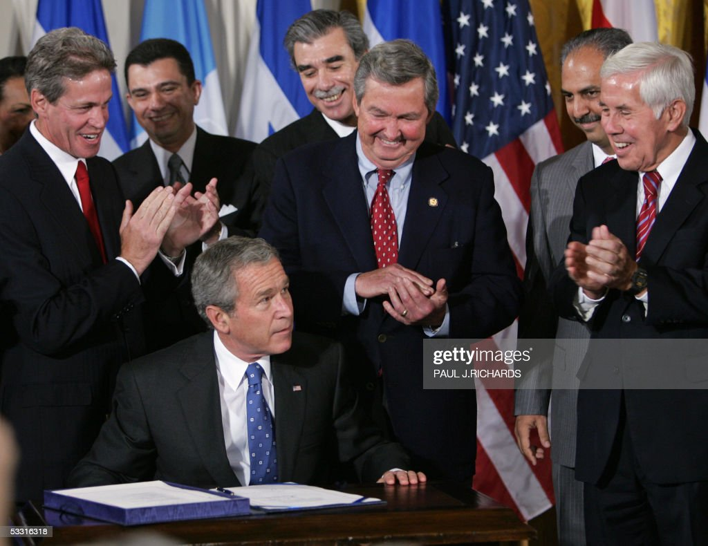 President bush signs the central american free trade agreement us president geoge w bush looks up after signing the central american free trade agreement platinumwayz