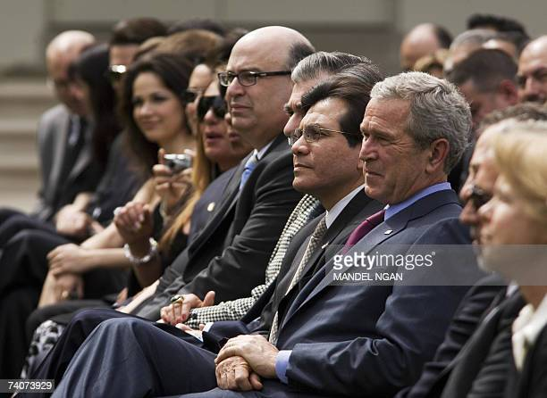 US President George W Bush and Attorney General Gonzales watch a band perform during a celebration of Cinco de Mayo 04 May 2006 in the Rose Garden of...