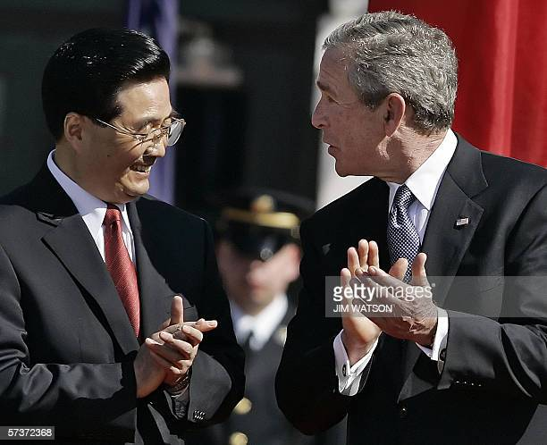 US President George W Bush and Chinese President Hu Jintao applaud during a welcoming ceremony on the South Lawn of the White House in Washington DC...
