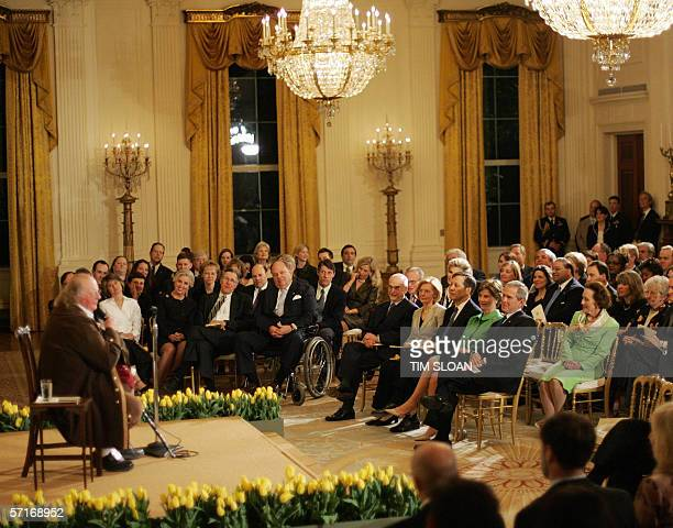 """Washington, UNITED STATES: US President George W. Bush and First Lady Laura Bush watch a performance by Ralph Archbold as """"Benjamin Franklin"""" to..."""