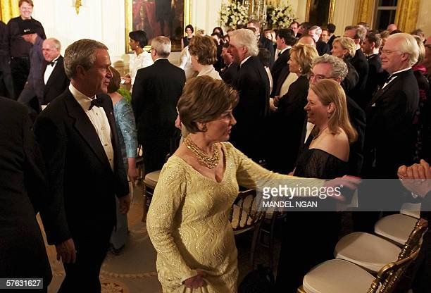 US President George W Bush and First Lady Laura Bush walk out of the East Room after attending a performance by country singer Kenny Chesney...