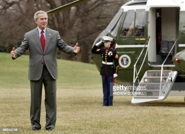 US President George W Bush awaits First Lady Laura Bush on the south lawn of The White House prior to boarding Marine One en route to Glen Burnie...