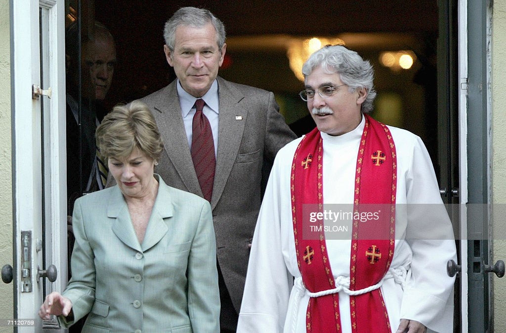 US President George W. Bush (C), First Lady Laura Bush and Rev. Luis Leon (R) leave St. John's Church after attending Sunday morning service 04 June 2006 across the street from White House in Washington, DC. AFP PHOTO/Tim SLOAN