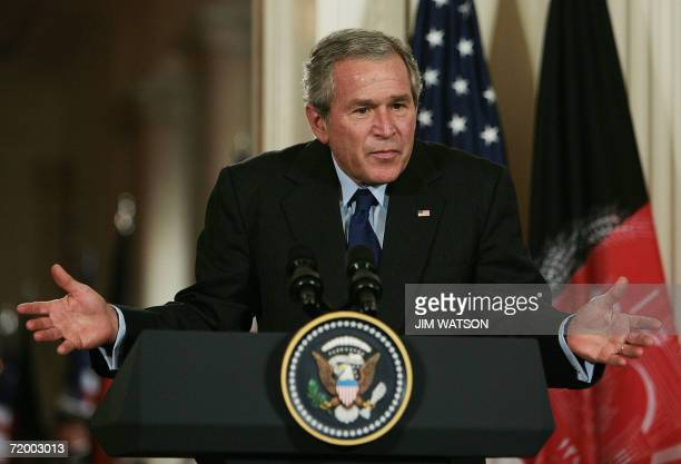 US President George W Bush gestures as he answers questions from the media during a joint press conference with Afghan President Hamid Karzai in the...