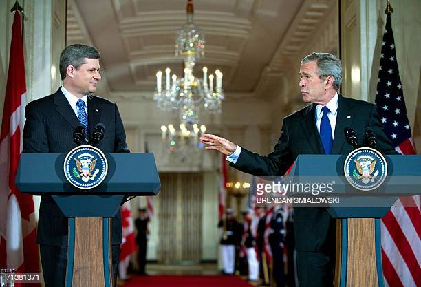 Washington, UNITED STATES: US President George W. Bush gestures toward Prime Minister of Canada Stephen Harper during a joint press conference in the...