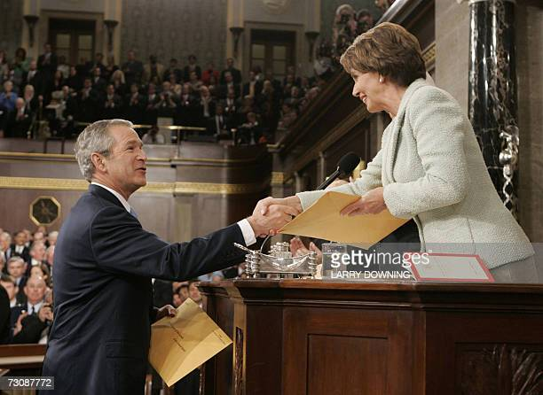 Washington, UNITED STATES: US President George W. Bush greets Speaker of the House Nancy Pelosi, D-CA, as he arrives to deliver his annual State of...