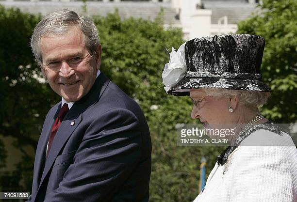 US President George W Bush looks over at Britain's Queen Elizabeth II of England while speaking during an official welcome ceremony 07 May 2007 on...