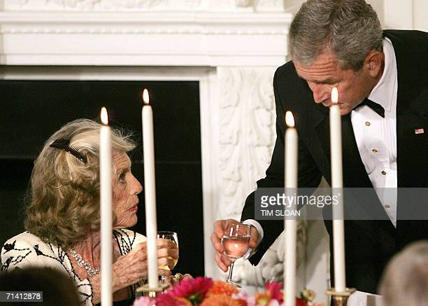 Washington, UNITED STATES: US President George W. Bush makes a toast to Special Olympics Founder Eunice Kennedy Schriver during a Social Dinner in...