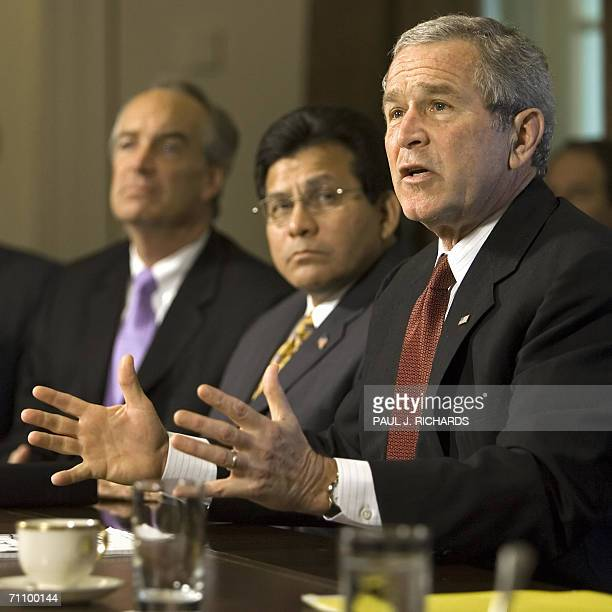 Washington, UNITED STATES: US President George W. Bush responds to questions on Iran during a photo opportunity while conducting a Cabinet Meeting 01...