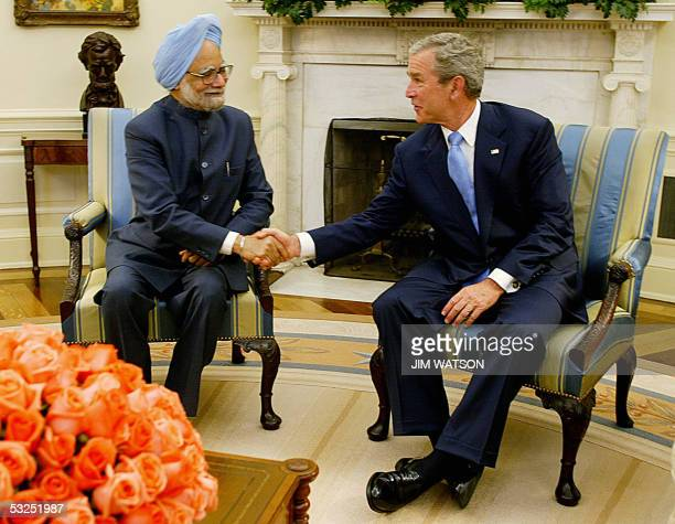 US President George W Bush shakes hands with Indian Prime Minister Dr Manmohan Singh in the Oval Office 18 July at the White House in Washington DC...