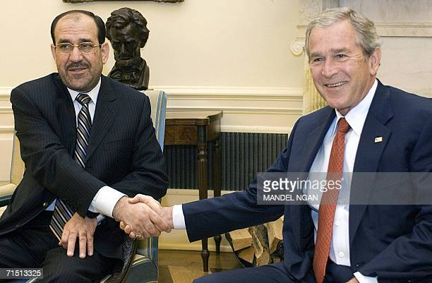 US President George W Bush shakes hands with Iraqi Prime Minister Nuri alMaliki 25 July 2006 during a meeting in the Oval Office of the White House...