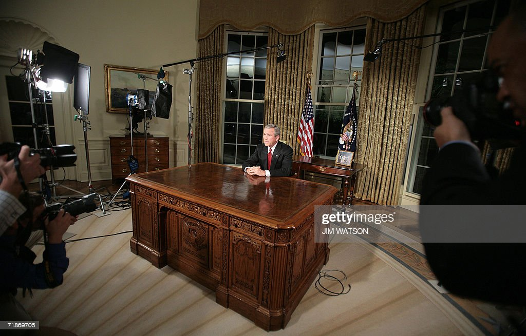 US President George W. Bush sits at his desk in the Oval Office of the White House in Washington, DC, 11 September 2006 after addressing the nation in a rare prime-time speech five years after the 11 September 2001 attacks on US soil. Bush told Osama bin Laden, whose Al-Qaeda network was behind the 11 September 2001 terrorist attacks, that US forces will find him 'no matter how long it takes.' AFP PHOTO/Jim WATSON