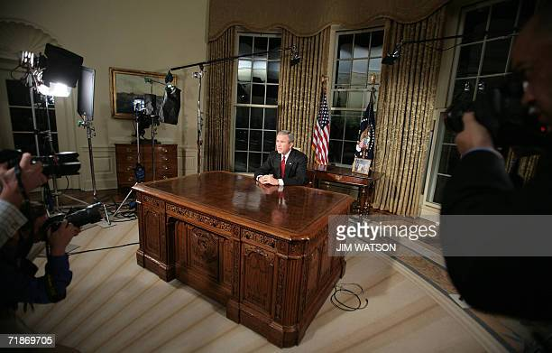 US President George W Bush sits at his desk in the Oval Office of the White House in Washington DC 11 September 2006 after addressing the nation in a...