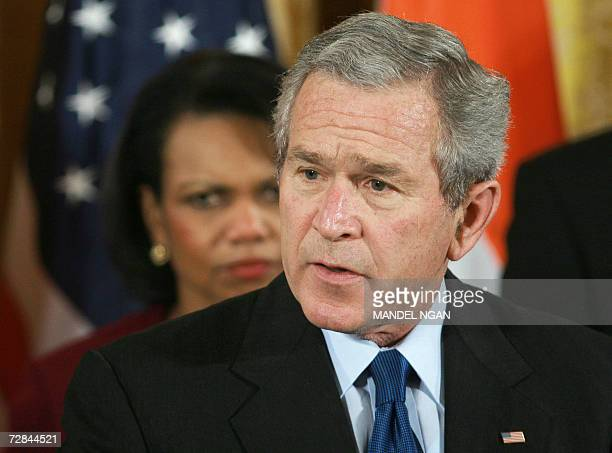 US President George W Bush speaks as Secretary of State Condoleezza Rice looks on before signing HR 5682 the United StatesIndia Peaceful Atomic...