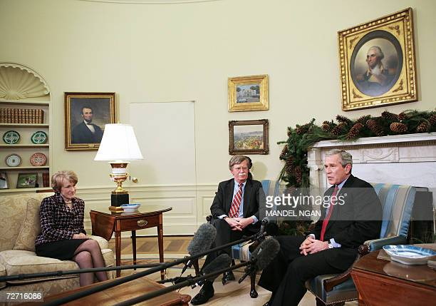 US President George W Bush speaks during a meeting with US Ambassador to the United Nations John Bolton 04 December 2006 as Bolton's wife Gretchen...