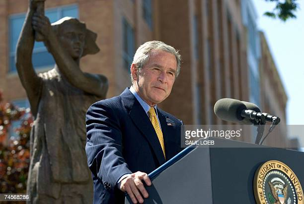 US President George W Bush speaks during the dedication of the Victims of Communism Memorial in Washington DC 12 June 2007 The memorial near Capitol...