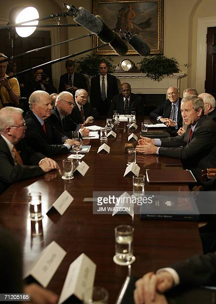 US President George W Bush speaks with former US Attorney General Edwin Meese III former Secretary of State James Baker III former member of Congress...