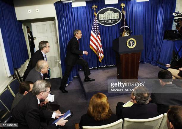 Washington, UNITED STATES: US President George W. Bush steps up for a press conference in the Brady Briefing Room 21 March 2006 of the White House in...