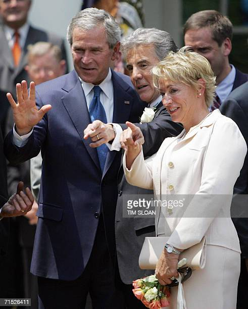 US President George W Bush talks with John Walsh and Walsh's wife Reve before the Signing of HR 4472 the Adam Walsh Child Protection and Safety Act...