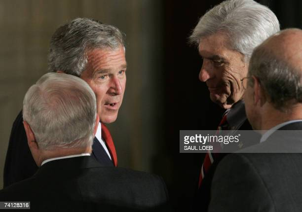 US President George W Bush talks with US Senator John Warner US Defense Secretary Robert Gates and an unidentified guest after an event commemorating...