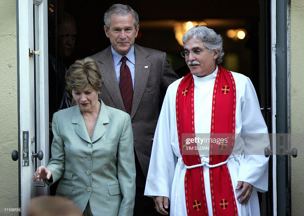 US President George W. Bush (L) waves as he leaves First Lady Laura Bush and Rev. Louis Leon after attending Sunday morning service outside St. John's Church 04 June 2006 across the street from White House in Washington, DC.