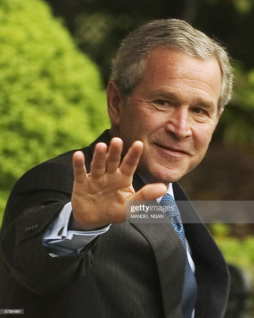 US President George W. Bush waves as he walks to Marine One 11 May 2006 on the South Lawn of the White House in Washington, DC. Bush is heading to Biloxi, Mississippi to deliver a commencement address. Prior to his departure Bush denied that US intelligence was 'mining or trolling' through the private lives of ordinary people, following press revelations that a military agency was tracking the telephone calls of tens of millions of Americans. AFP PHOTO/Mandel NGAN