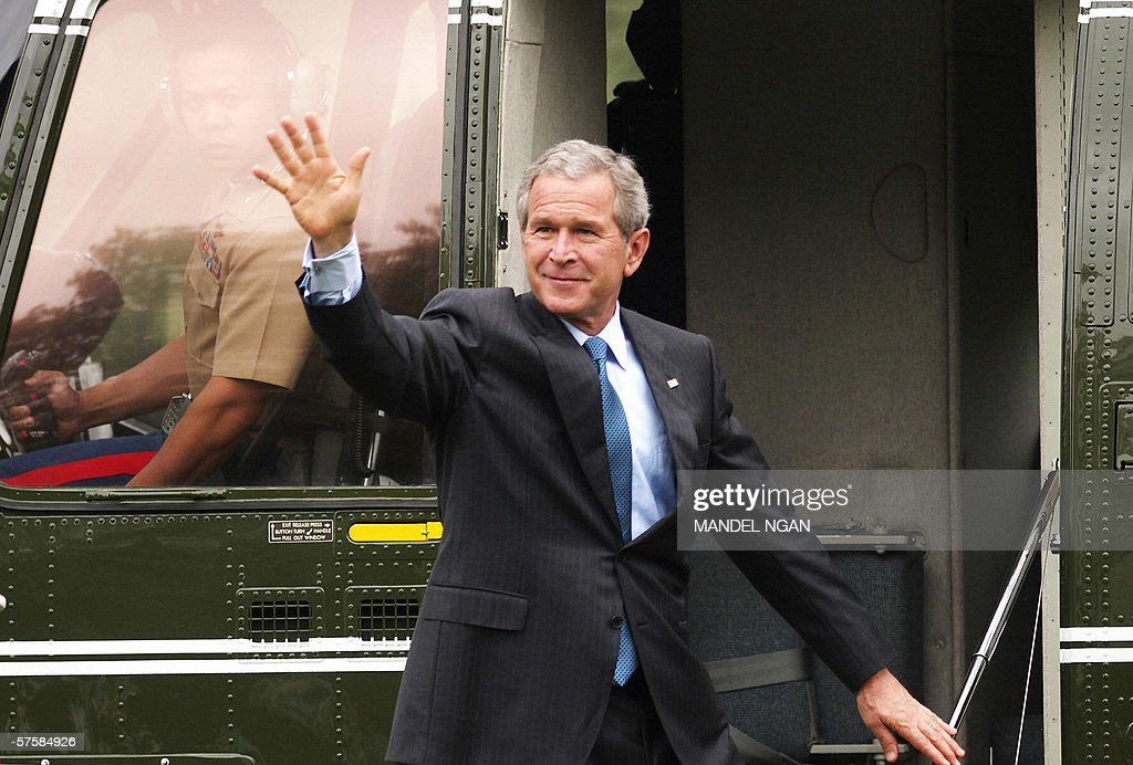 US President George W. Bush waves before boarding Marine One 11 May 2006, on the South Lawn of the White House in Washington, DC. Bush is heading to Biloxi, Mississippi to deliver a commencement address. AFP PHOTO/Mandel NGAN